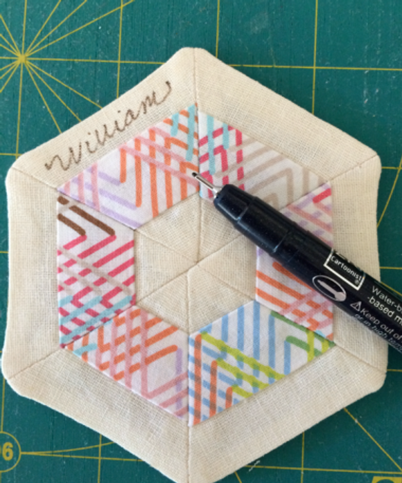 Mini hexie quilt label made with scraps.