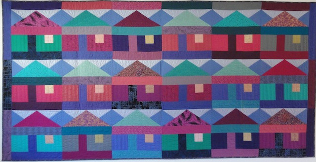 """Rowhouse, 75"""" x 38"""", designed and pieced by Diana McClun and Laura Nownes, hand quilted by Anna Venti"""