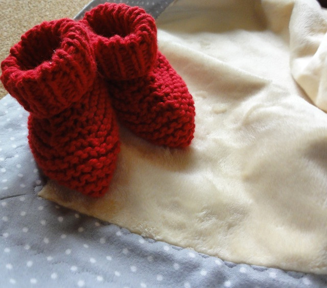 Simple knitted baby booties.