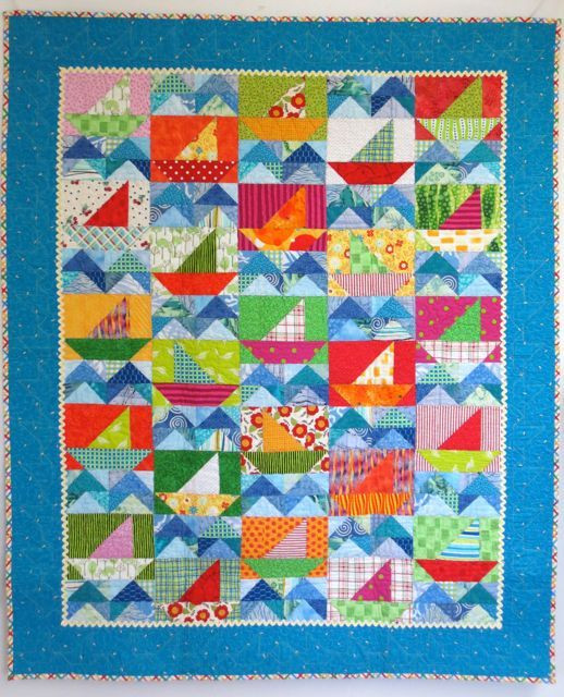 """Little Sailor, 40"""" x 50"""", designed and made by Darra Williamson and machine quilted by Chris Porter, from their book, Cuddle Me Quick. Look closely: three boats sail against the wind."""