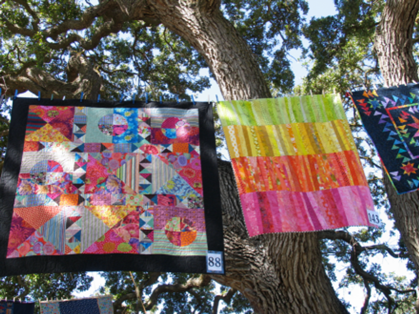 Quilt-J:  Heart Strings hanging at Quilting in the Garden