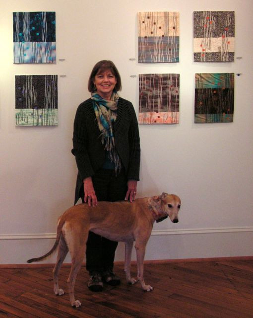 Linda Smith with some pieces from her recent Meditation series shown in Macon (GA) earlier this year. Her friendly companion is China, pet of the gallery director.