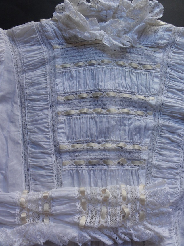 Front detail of my hand sewn wedding dress. Too bad neither of my daughters will want to wear it.