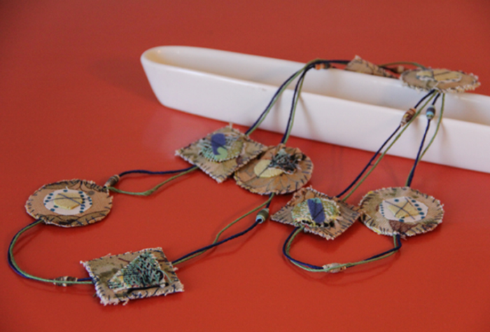 Tana's wonderful rendition of a project from the fabric jewelry book.