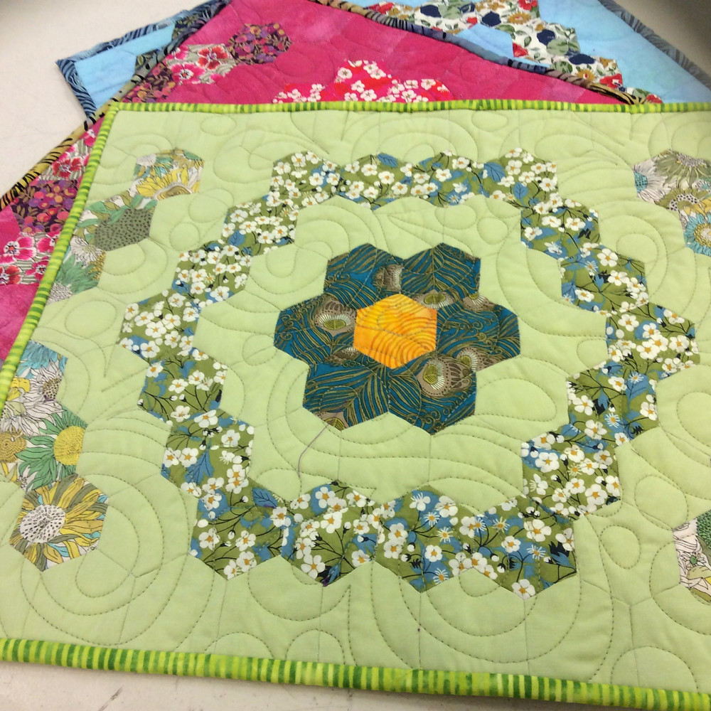 Hexie placemats made by Mina Askari. Machine quilted by Kerry Reed.
