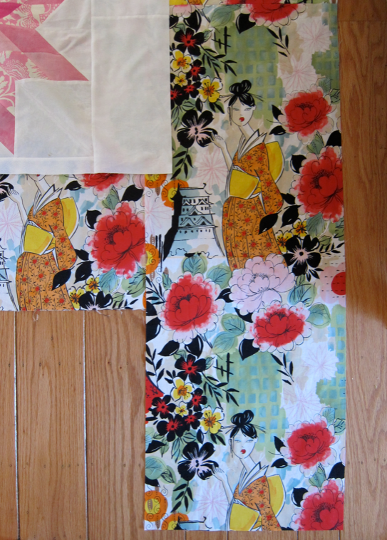 Boy, I squeaked by here--12 square inches of backing fabric left over!