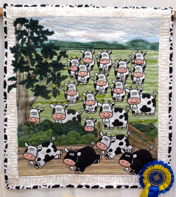 """Jean Bartlett of Devon made great use of a whimsical cow print in her quilt, Till the Cows Come Home. Looks like this one took a ribbon in a previous competition. Note the """"moo"""" quilting in the border!"""