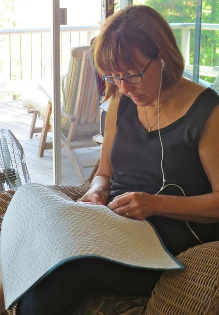 Stitching down the binding; I can guarantee that's country music coming through those earbuds!