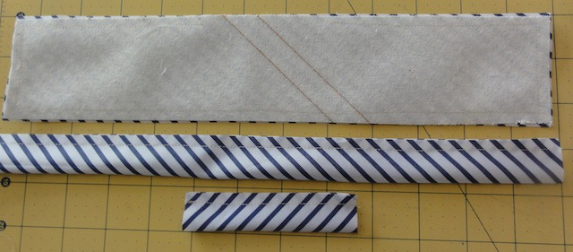 Main fabric strips are placed right sides together then place interfacing on top. Stitch around edges.