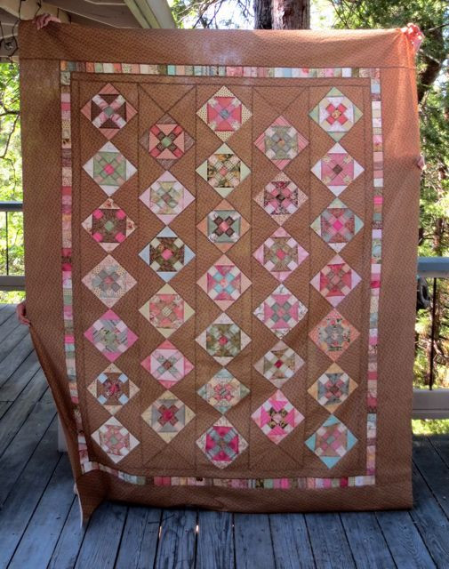 """Churn Dash quilt top (60"""" x 78""""), made by Darra Williamson...fingers not included!"""