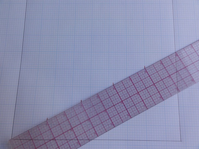"""Position your ruler exactly as shown. Then make small marks every 2"""" along the length of the ruler - 2"""", 4"""", 6"""" 8""""."""