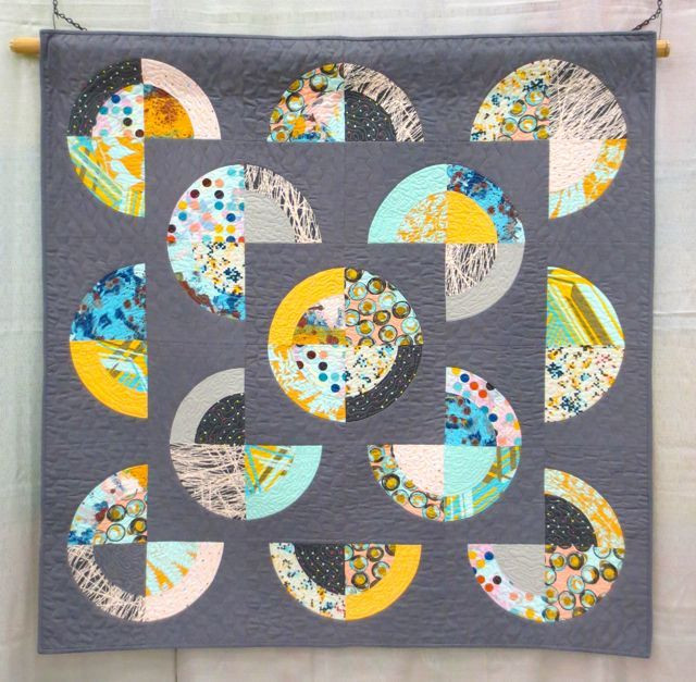 Just One More Slice, made and machine quilted by Patty Simmons, inspiration:  crop circles as seen from the air (QuiltCon 2013, category: Piecing, Large)