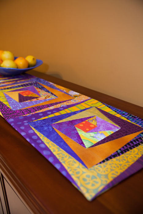 """Log Cabin/Split Level tablerunner (12 1/2"""" x 64 3/4""""), designed and made by Pam Dinndorf--one of the projects that includes pattern pieces, if you are so inclined"""