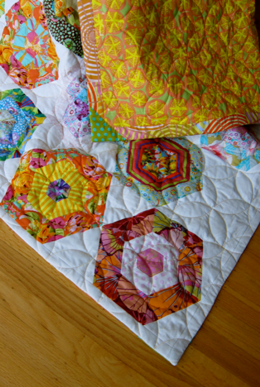 """The many design elements of """"My Fair Lady"""" in view:  finished quilt with completed faced binding and machine-quilting in """"Orange Peel"""" by Deb McPartland."""