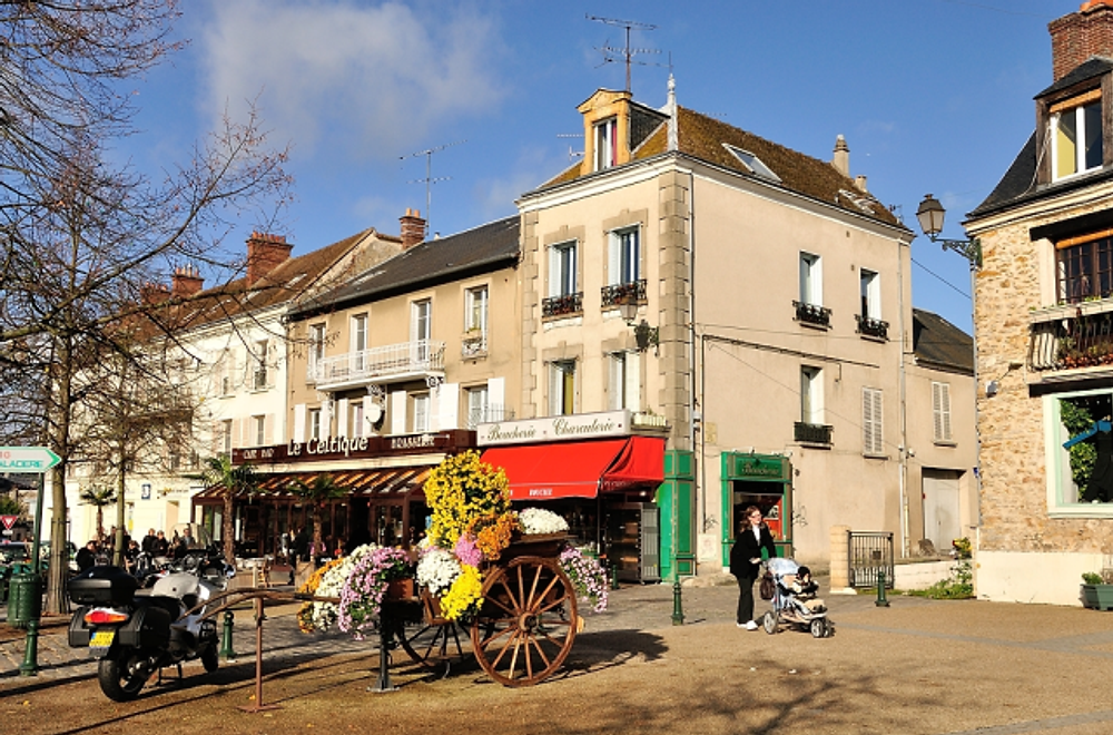 Street life--strolling through a small town in France, again by William Rounds.