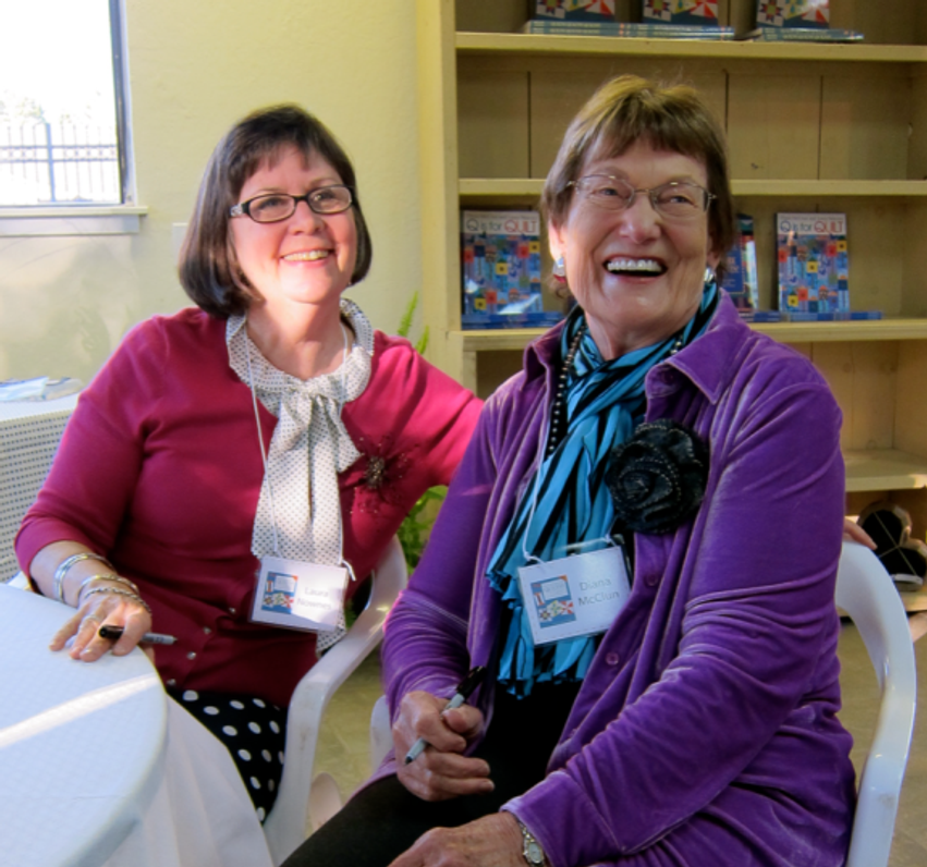 Laura Nownes and Diana McClun celebrating the publication of a brand new edition of Quilts!Quilts!!Quilts!!!