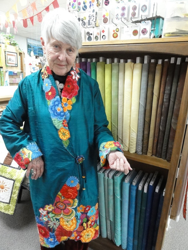 A beautiful example of Margaret's collage work used to border her silk jacket.