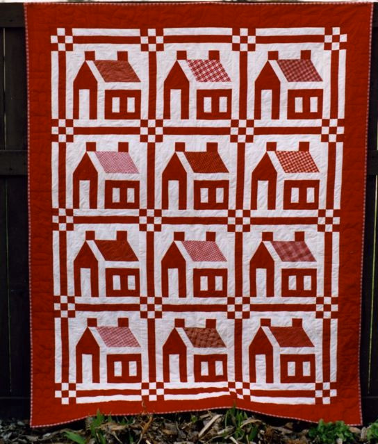 """Little Red Schoolhouses, made and quilted by Mary Stori, 56 1/2"""" x 71 1/4"""""""