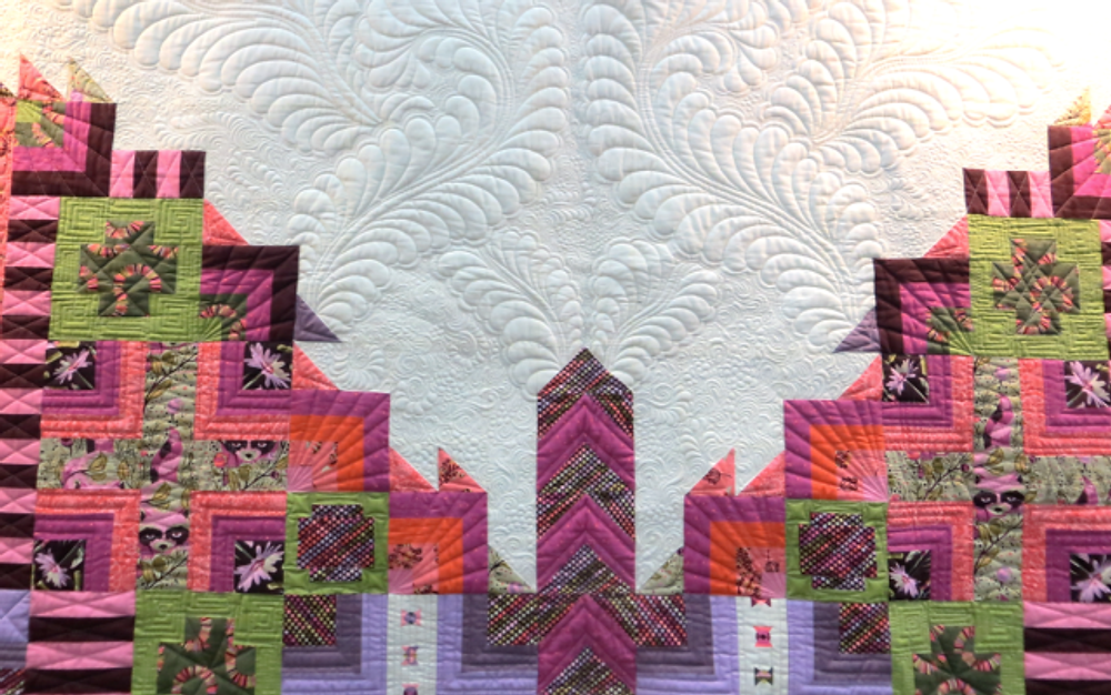 Detail of Angela's quilting on Tula Pink's butterfly quilt.