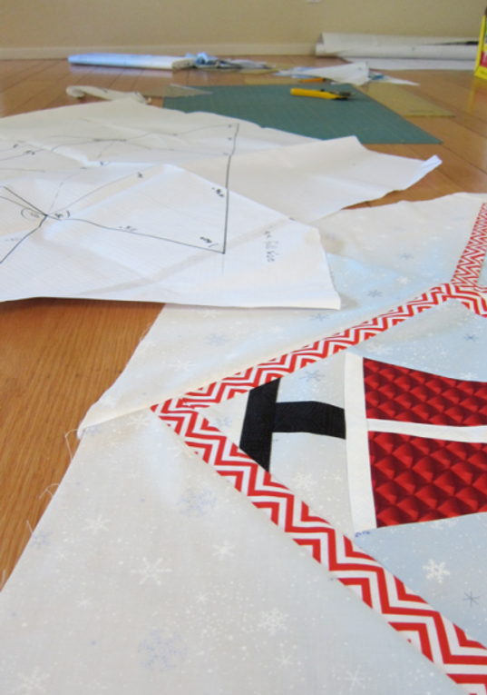 Working on the first Christmas Tree skirt prototype on the living room floor.