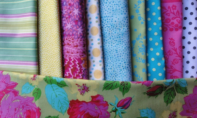 Fabrics for my new sampler quilt. I just can't get away from dots!