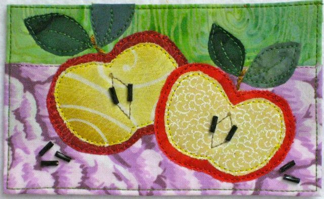 """""""An Apple a Day"""", 3"""" x 5"""" collage by Darra Williamson."""