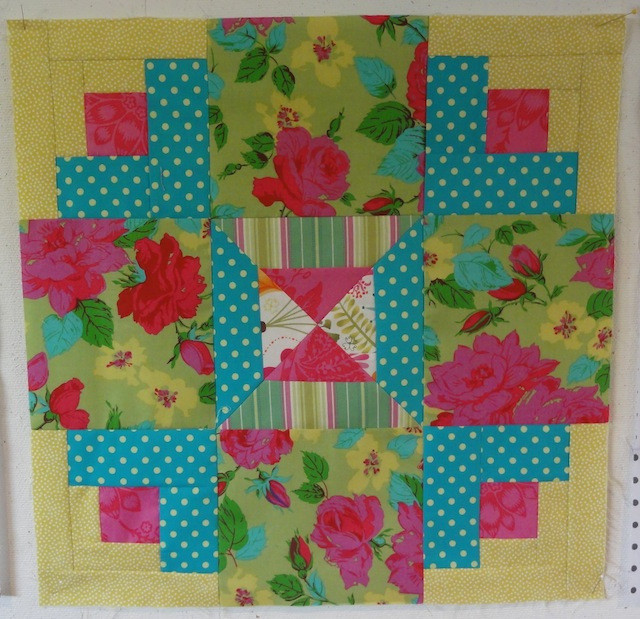 Floral fabric added to empty spaces to complete the block.