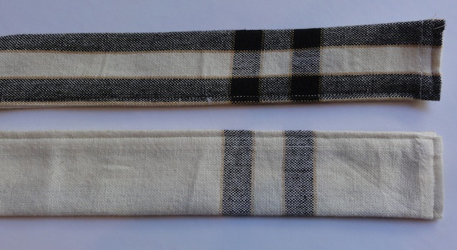 Fold, press and stitch strips in half lengthwise. Photo indicates both front and backside of ties.