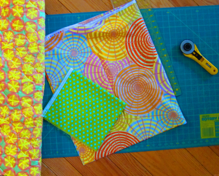 Backing fabric shown on left, faced binding is the umbrella fabric and the accent triangle in green/blue polka dot.