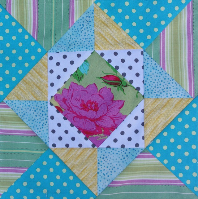 Here's the same block, reduced in size. I added outer triangles to make it larger.