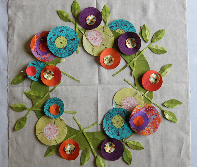 Close to final draft of wreath layout--notice the stay stitching around the perimeter of the linen background block.