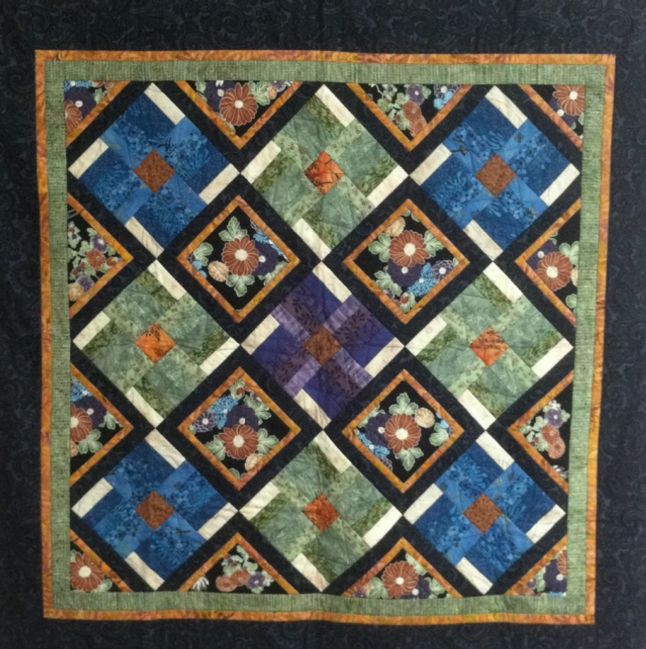 Made by Valerie Yeaton. Spring Blooms pattern by From Me to You.