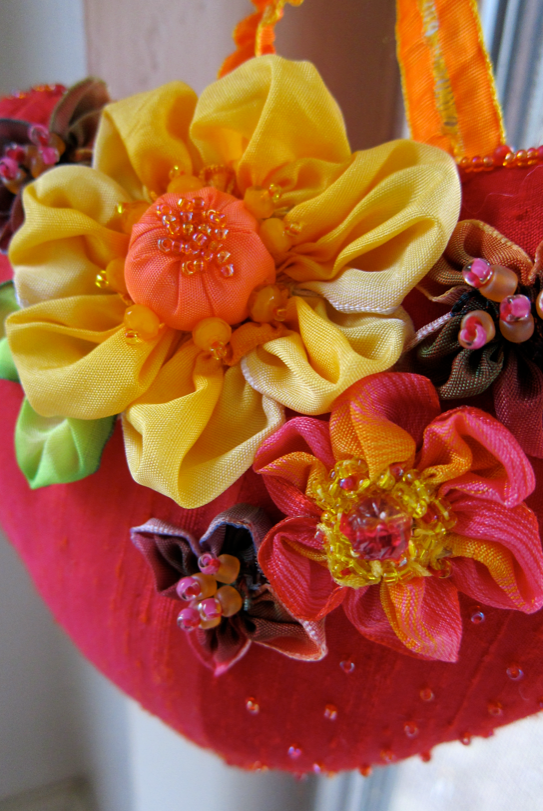 Inspired by Candace Kling, here's my take on silk ribbon flowers with beads and ribbon plundered from my stash.