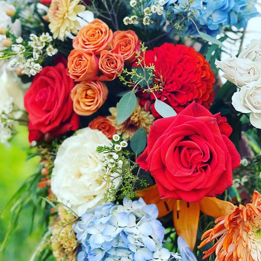 orange and blue wedding flowers.jpg