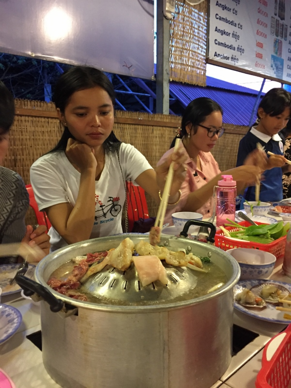 Enjoying steamboat Khmer style
