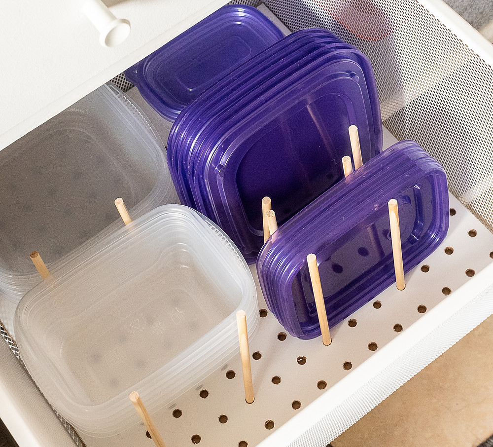 Clear plastic tupperware containers stored in a shelf