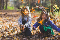 photo-of-children-playing-with-dry-leave
