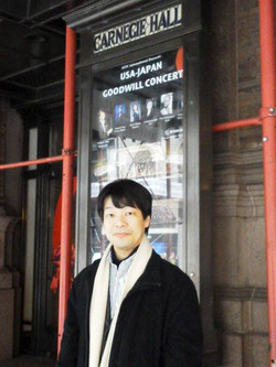 Maestro Hirai with Carnegie poster