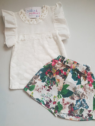 White beaded top & floral shorts