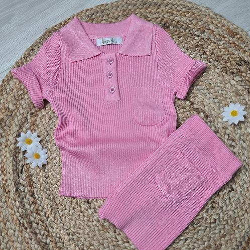 Pink ribbed polo and cycling shorts