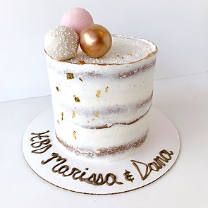 Naked Cake with gold leaf, gold painted trim, and cake pops