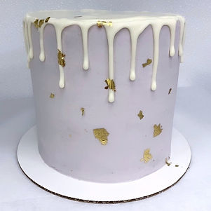 Purple drip cake with gold leaf