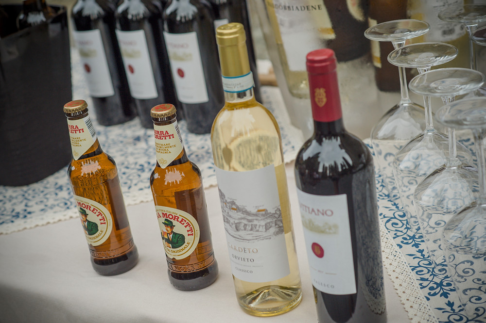 Itallian beer and wine displayed on a blue and white cloth