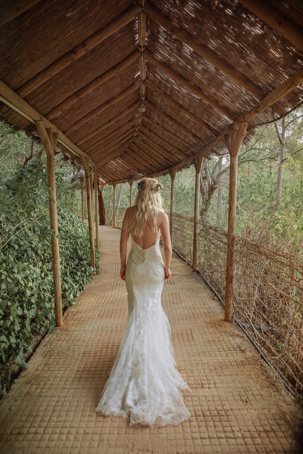 Bride walking down path to her ceremony in Portugal
