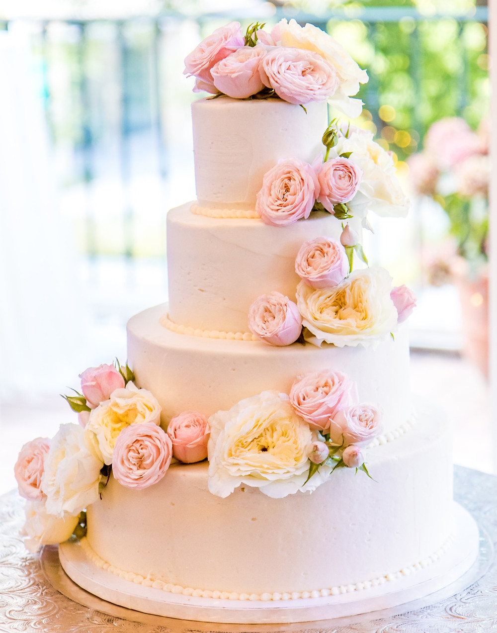 4-tier-white-wedding-cake-decorated-with-pink-and-white-roses