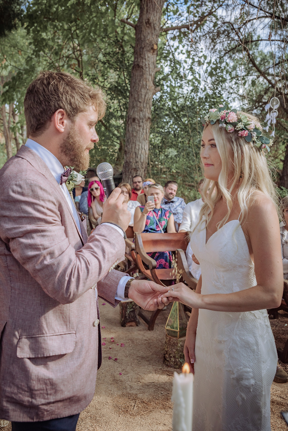 Bride and groom taking their wedding vows in a forest in Portugal