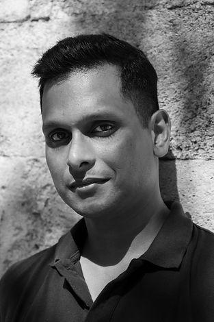 Portrait photograph of John Jethi