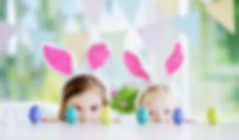 Two cute little sisters wearing bunny ea
