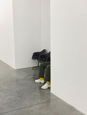Person sitting at White Cube