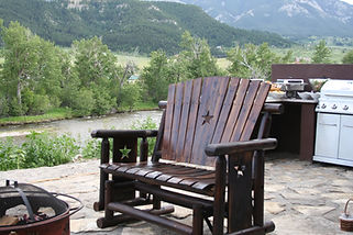 Outdoor granite kitchen and stone patio overlooking Stillwater River and Beartooth Mountains